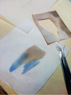 ■切り抜いたパーツを台紙の和紙に貼り込んでいく